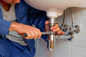 plumber fixing shower leaks